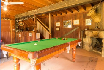 The pool room at Hunter Escape has an open fireplace, dartboard and Queen bedroom with en suite...